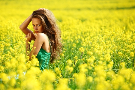 woman on oilseed field close portrait Stock Photo - 9961399