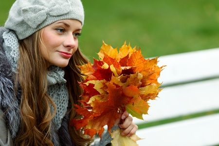 woman portret in autumn leaf close up Stock Photo - 9961682