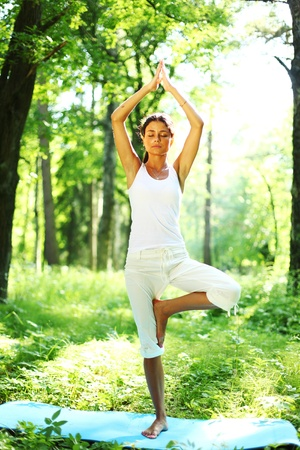yoga woman on green grass in forest Stock Photo - 9961649