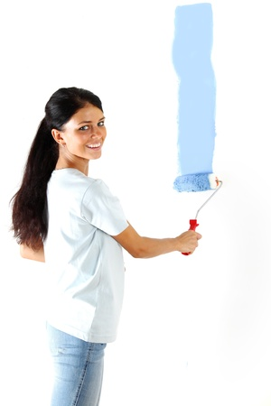 roller in woman hand paint on the wall Stock Photo - 9961180