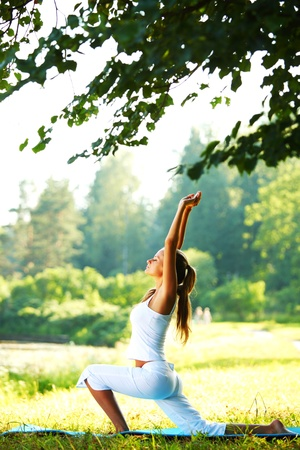 healthy person: yoga woman on green park background Stock Photo