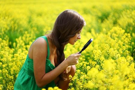 botanist woman in yellow flower field Stock Photo - 9961415