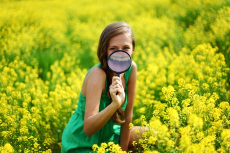 botanist woman in yellow flower field Stock Photo - 9961410