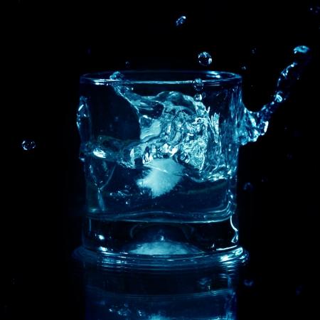 bourbon: alcohol splash on black background close up Stock Photo