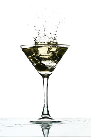 martini splash: martini glass splash bar background Stock Photo