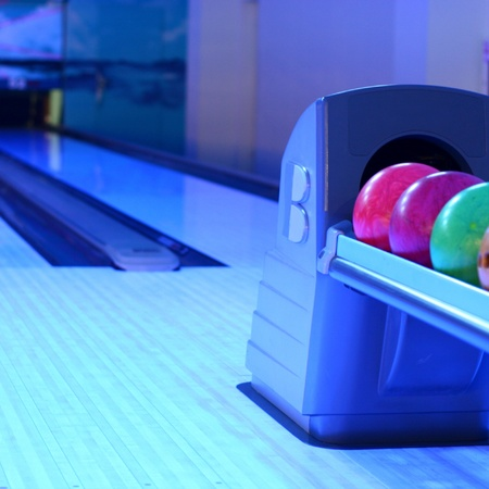 colored bowling bolls in a row  photo
