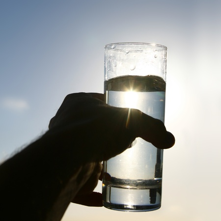 hand water: cold morning drink in glass Stock Photo