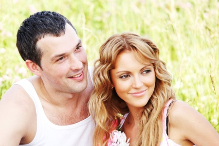 two lovers on grass field Stock Photo - 10001250