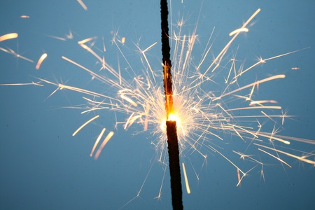 sparkler fire on blue macro background close up Stock Photo - 10001480