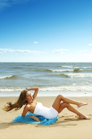 woman laying on sand sea on background Stock Photo - 10023052