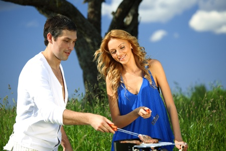 man and woman on picnic in green grass Stock Photo - 10023053