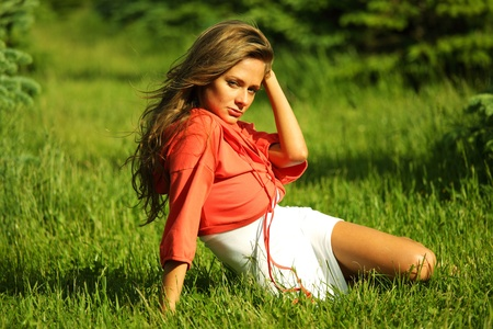 young sommer woman on green grass photo