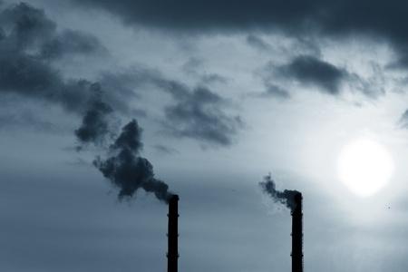 emissions: factory emissions danger to nature concept