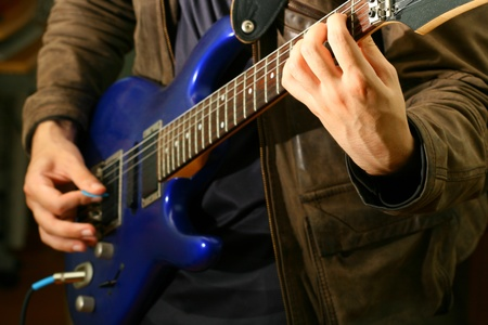 melodies: man play solo on blue guitar