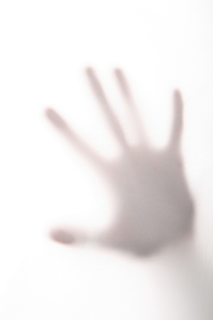 frosted window: horror hand