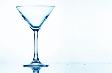 martini splash: martini glass splash bar background Stock Photo