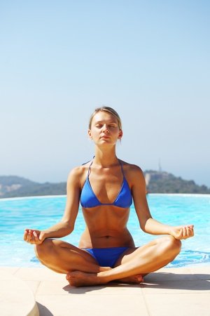 yoga woman pool on background photo