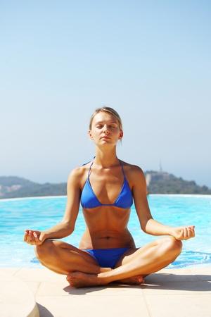 sportswear: yoga woman pool on background