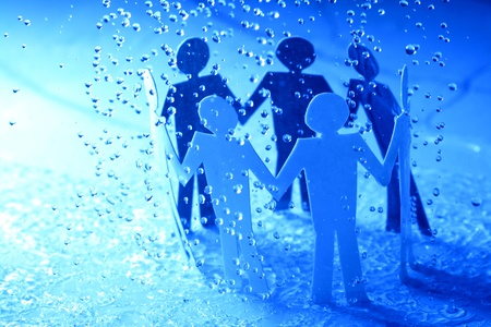 paper team linked together under rain weather concept Stock Photo - 10073392