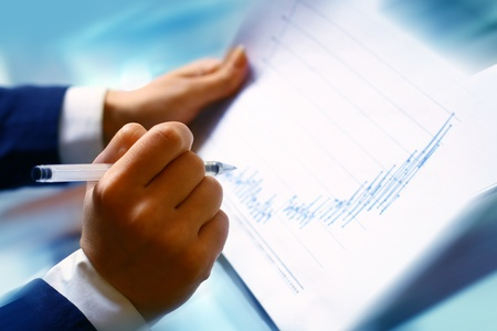 read the graph in financial report Stock Photo - 10073633
