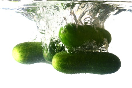 cucumber splash isolated on white background photo