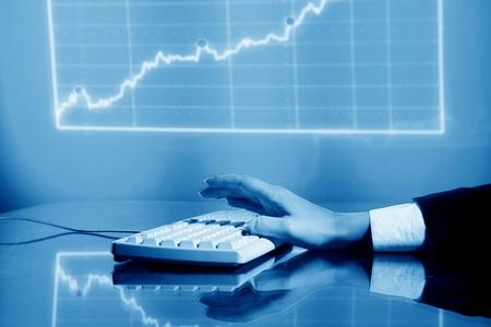 businessman input finance data information on keyboard photo