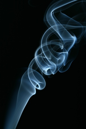 incense sticks: blue smoke on black background Stock Photo
