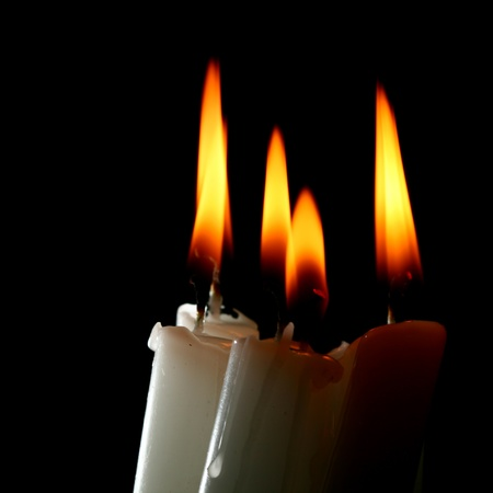 christmas memories: sacred candles in dark on black background
