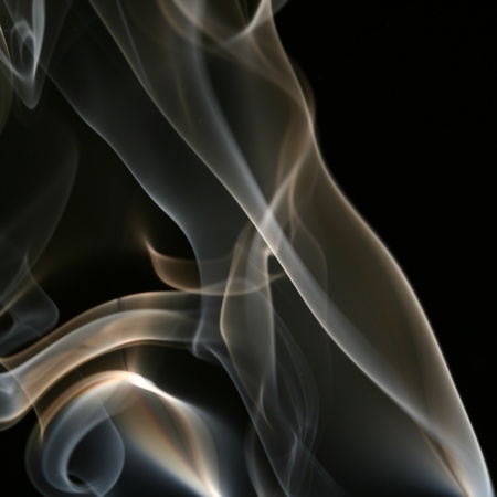 incense sticks: colored smoke abstract background close up