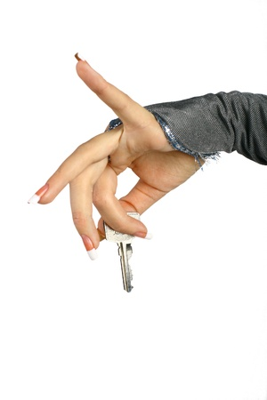 gives: The woman hand gives the key on a white background Stock Photo
