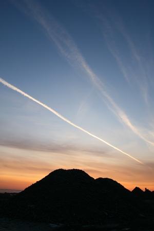 skie: sunrise on blue indigo sky