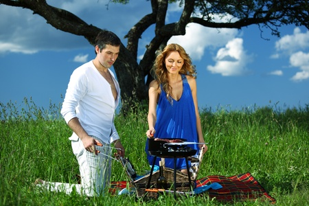 man and woman on picnic in green grass Stock Photo - 10164149