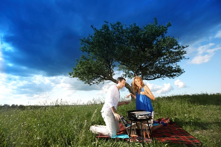 man and woman on picnic in green grass Stock Photo - 10164187