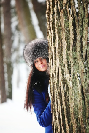grins: winter women close up portrait in frost forest