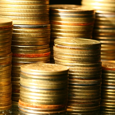 wage: golden coins macro close up