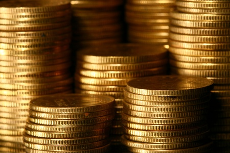 coin stack: golden piles of coins macro background