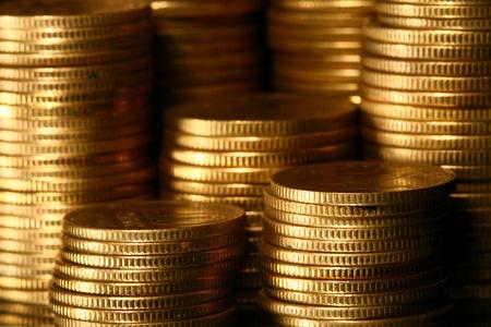 golden piles of coins macro background Stock Photo - 10170909