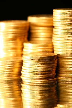 golden piles of coins macro background photo
