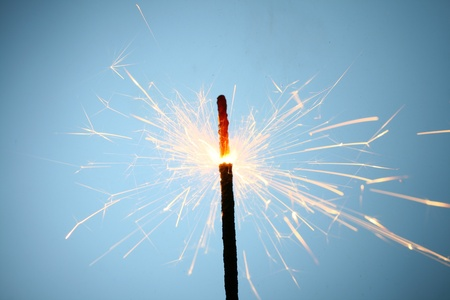 sparkler fire on blue macro background close up Stock Photo - 10171065