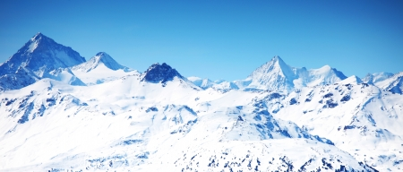 top of mountains sun in blue sky photo