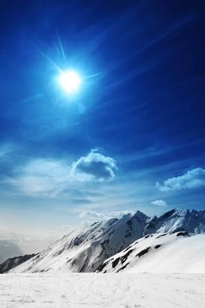 snowstorm: top of mountains in blue sky Stock Photo