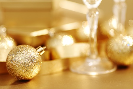 new love: golden christmas background champagne gifts ball Stock Photo