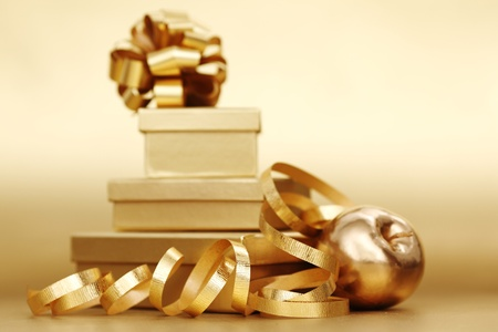 golden christmas gifts on gold background Stock Photo - 10254847