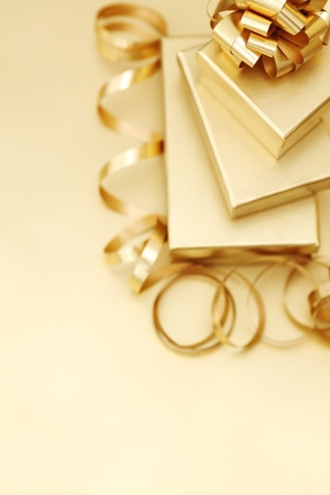 golden christmas gifts on gold background  photo