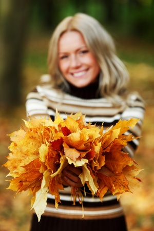 woman portret in autumn leaf close up Stock Photo - 10260602