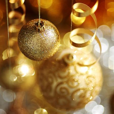 golden christmas balls on bokeh background Stock Photo - 10233774