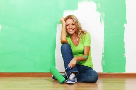 woman paints the wall brush isolated photo