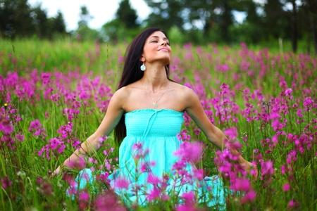 woman on pink flower field close portrait Stock Photo - 10260612