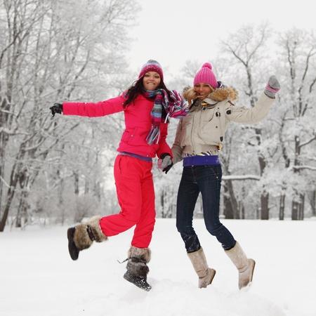 winter girl jump on snow background photo