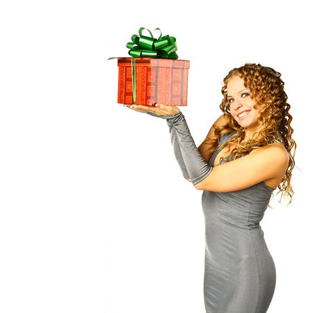 The girl with a gift in cheerfully box smiles new year Stock Photo - 10270767